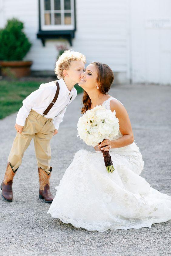 Ring bearer in cowboy boots! // photo by Kina Wicks http://ruffledblog.com/romantic-illinois-farm-wedding/: