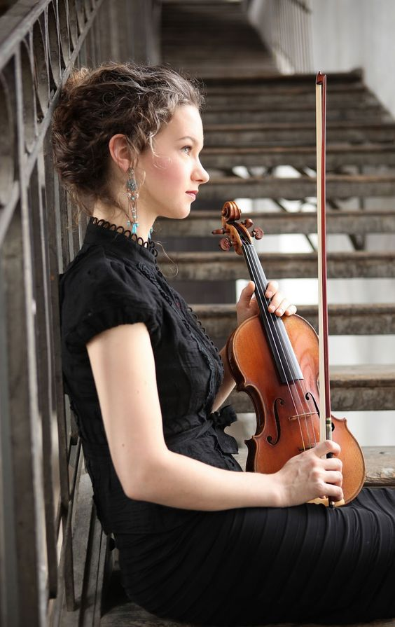 Hilary Hahn resting with violin. Photograph by Peter Miller. Hahn, 31, has made her career by straddling core concerto and recital repertoire with modern repertoire. She won her first Grammy in 2001 with a recording of Brahms and Stravinsky concertos with Neville Marriner and Academy of St. Martin-in-the-Fields. Another Grammy followed in 2008 with Schoenberg and Sibelius concertos with the Swedish Radio Philharmonic, Esa-Pekka Salonen conducting.