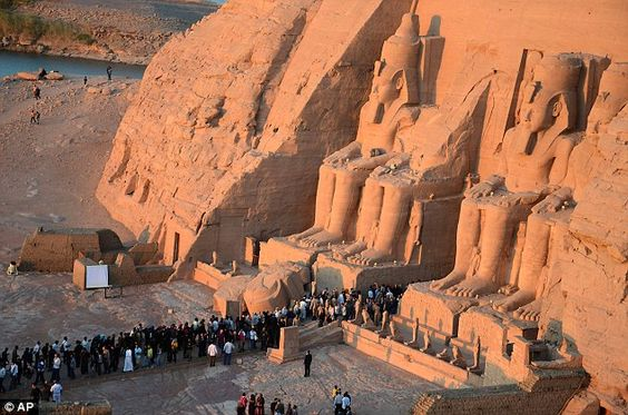 People visit the Great Temple of Ramses II to watch the sun illuminate its dark inner cham...
