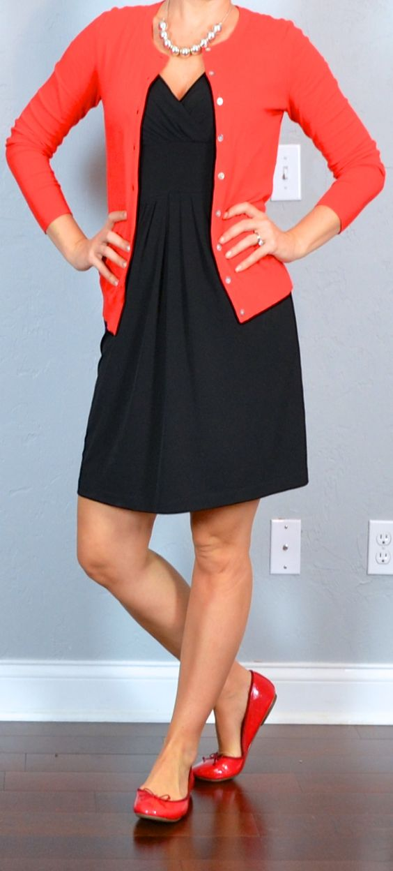 Red cardigan, black dress, and red ballet flats: