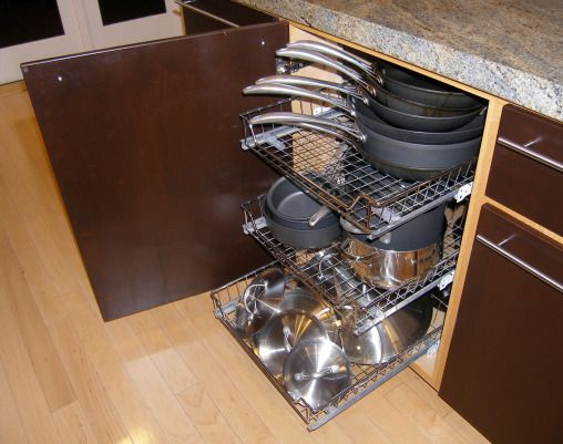 Roll-out storage racks keep cabinets organized and pots and pans ...
