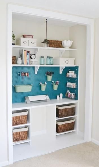 convert a closet to have desk space on bottom but maybe still hanging poles on one or both sides. Like the painted peg board to use for storage and display.: