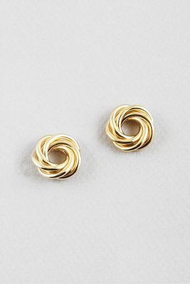 Metallic braided twist circle studs in gold. Pair with your basic tee or your party dress. Shop now at cinnaryn.com.