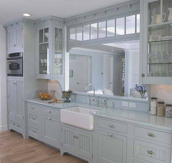 Apron front sink ✓  Furniture style legs ✓  Solid surface countertop ✓  Under cabinet lighting ✓  Inset doors ✓