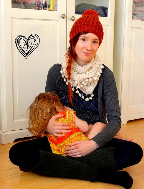 #Breastfeeding a toddler. (Love the scarf!)