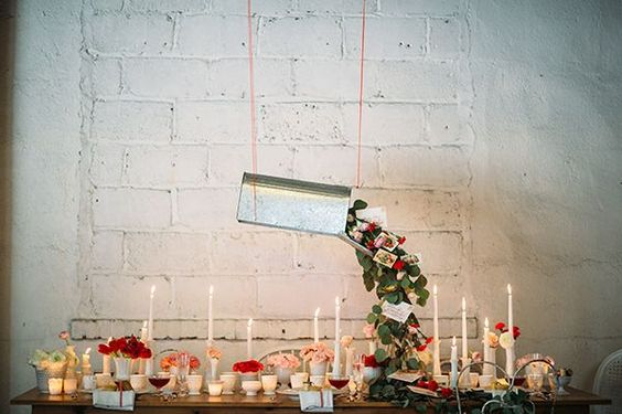 Hearkening back to the days when love letters were sent by post, a galvanized antique mailbox was transformed into a suspended centerpiece, out of which spilled a cascade of seeded eucalyptus leaves, candy-colored blooms, and old-timey valentines in hand-calligraphed envelopes. | Photo by Jessica Oh | Styling by Dovetail Vintage Rentals #ValentinesDay:
