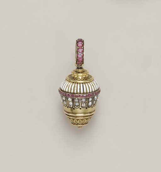 AN ANTIQUE RUBY, DIAMOND, ENAMEL AND GOLD VINAIGRETTE   Designed as a gold acorn with a chased gold foliate terminal, to the rose-cut diamond and black enamel dot detail with cushion-cut ruby trim and white enamel top, to the black enamel detail and ruby pendant hoop, (one ruby deficient, with damage to enamel), circa 1870