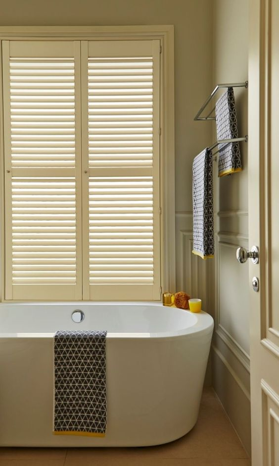 Different shades of colour in focal points such as windows and doors create a lovely subtle scheme in a room. Add bright patterned accessories to add some fun. made to measure cream Shutters a the perfect way to complete this look.