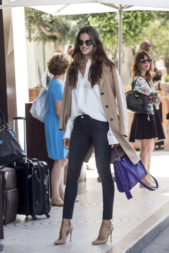 I love how timelessly classic and chic the tan trenchcoat, the white blouse, the dark pants, and the sunglasses are.
