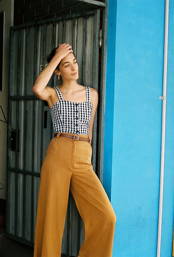 black and white gingham sleeveless corset crop top + mustard yellow high waisted wide legged pants + black strappy flat sandals + brown belt