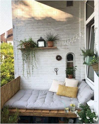heerlijk bed om te relaxen op je balkon