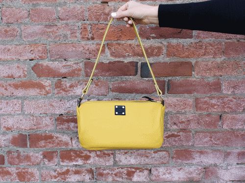 SF Leather Handbag from San Filippo Leather. Available in red, yellow, cream and blue-gray. American made leather goods.