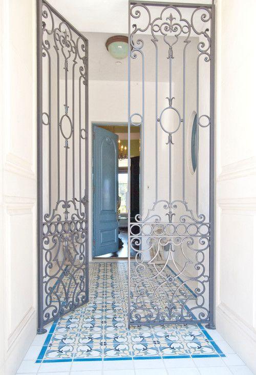 Blue front door, iron gates. Tower Road mediterranean, Dallas. J. Wilson Fuqua  Assoc. Architects.
