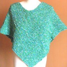 Cape/poncho en laine peignee