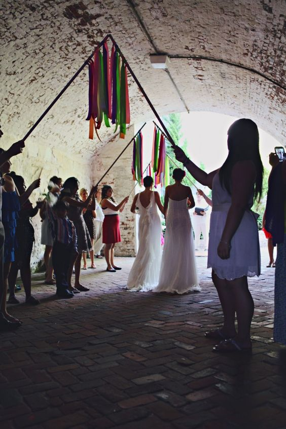 Rainbow ribbons to walk under at your outdoor wedding add color and motion!