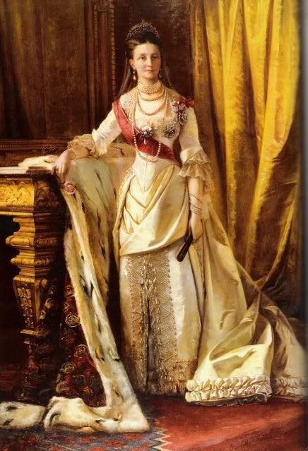 Queen Louise of Denmark in Russian court dress. She was the consort of Christian IX, and two of her daughters were Alexandra, queen of Edward VII of Great Britain, and Marie Feodorovna, Empress of Russia. I suspect that this was painted to commemorate her daughter being crowned Empress of Russia in 1882.