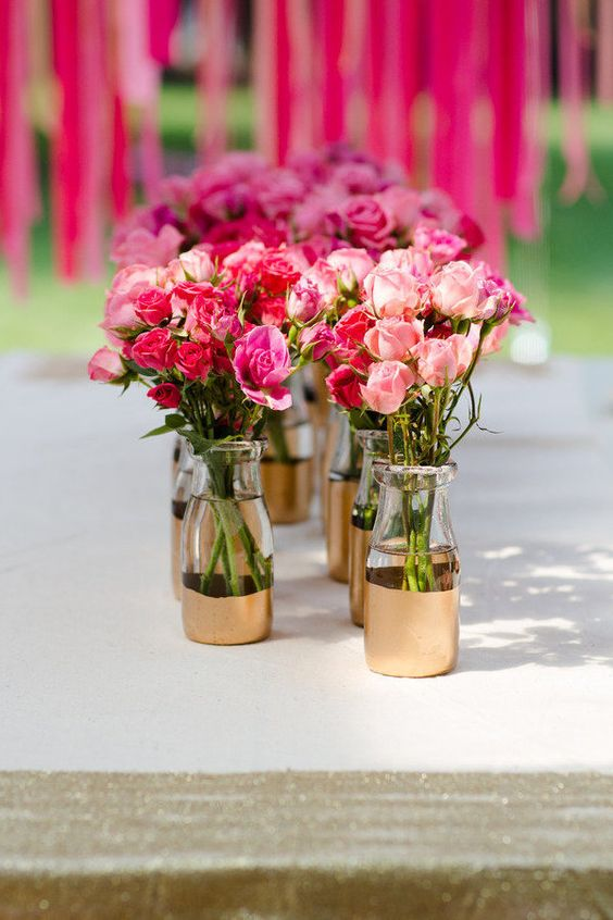 Half painted milk bottle as a vase and gorgeous pink rose bouquets do make a great decorative element for a peppy mehendi decor | These 20 Unique Floral Centrepiece Ideas Are Irresistibly Screenshot-Worthy! | Function Mania