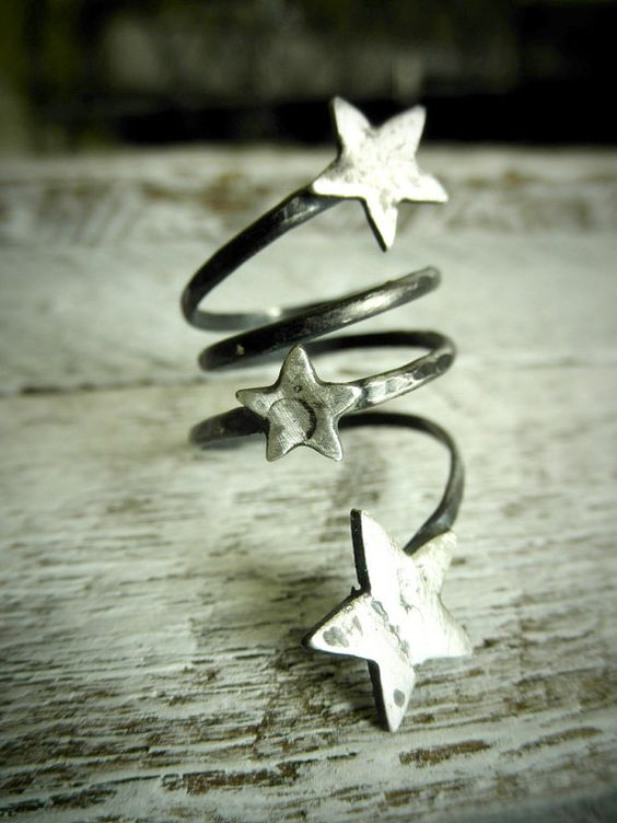 Silver star ring.