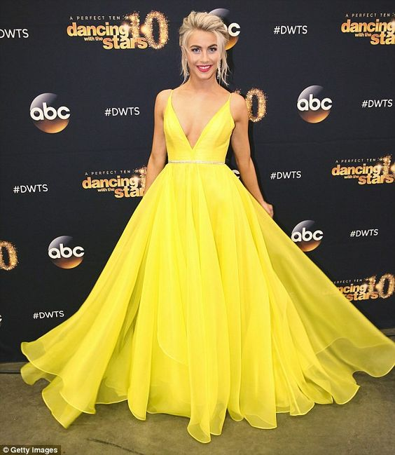 Eye-catching: Julianne Hough stood out in a bright yellow gown as she arrived for the seas...