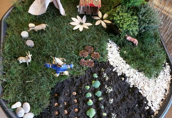 In the garden small world at Chadwell Pre-school