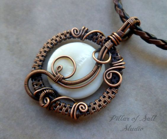 Handmade wire wrapped pendant, a one of a kind jewelry piece. This wire wrapped pendant was made with a white mother of pearl bead.