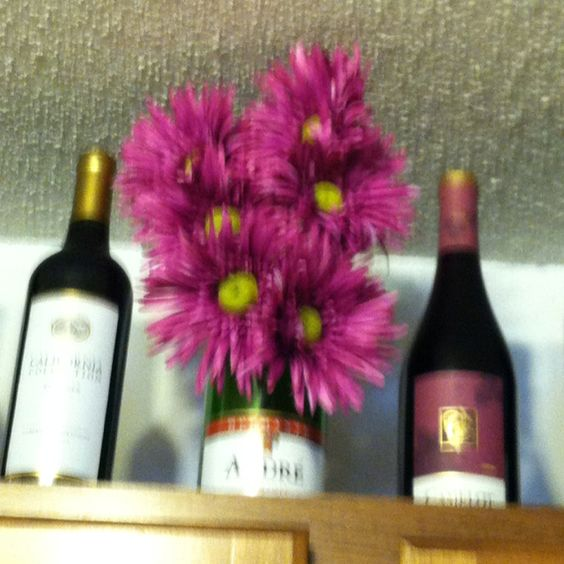 Took our champaign bottle and made it look like flowers were coming out of it.