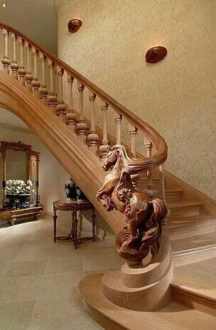 Just imagine sliding down this banister and onto a horse. I'm on a horse. - Custom carved wooden stairs