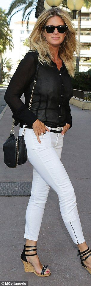 Hot stuff: The mother-of-two also showed off her long legs in a pair of skinny white jeans...