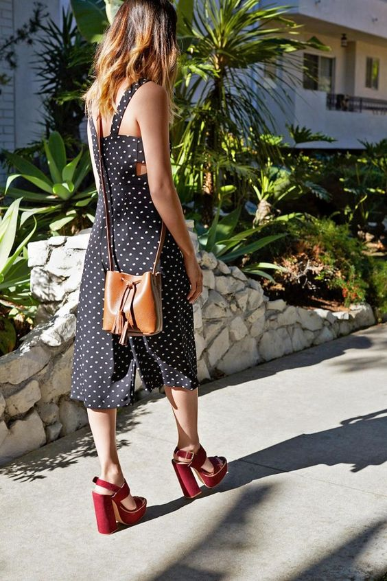 Team Zoe pairs the Shaffer LA bucket bag with a printed romper with platform sandals for a chic weekend look
