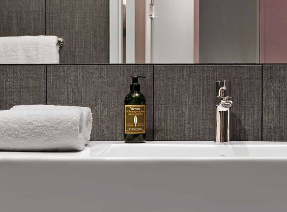 Relaxation awaits in our menswear-inspired bath, where there are deluxe rain showers, Frette towels and L'OCCITANE en Provence toiletries.