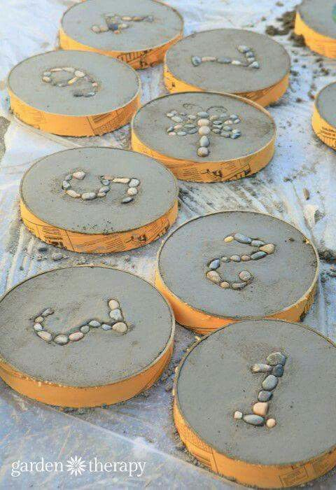 Numbers and letters used in rocks and cement! They can be used as stepping stones too!