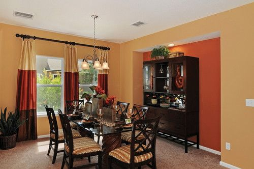 The Formal Dining Room In The Hollowaygreat Yellow And Orange Adorable Dining Room Furniture Jacksonville Fl Decorating Inspiration