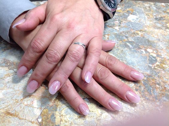 #7. Surely Natural: Opaque pink acrylic nails with gel coating. (Luxury Nails, Dyersburg, TN)