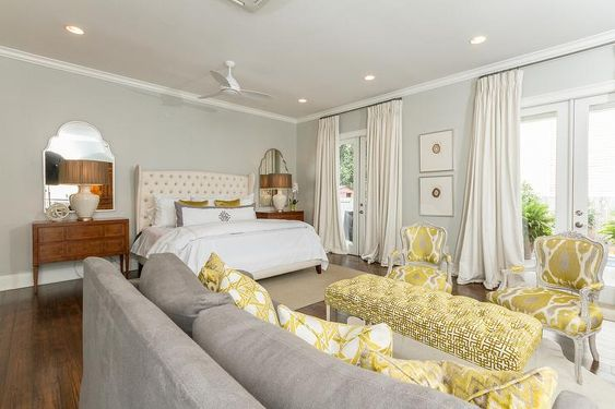 Yellow And Gray Bedroom Sitting Area Features A Gray Sofa