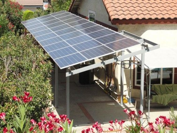 using solar panels to create a shade structure next to the house -- I must look into this later...: