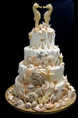 ~♪Awesome Beach Wedding Cake♪~ we want a beach themed cake... I'd like this one in a little less busier version! Kissing seahorses are super cute though!!!
