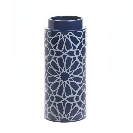 Inspired by the deep blue night sky scattered with bright white constellations, this mesmerizing ceramic vase will deliver starry style to any living space. Its high-gloss finish and stunning geometric pattern makes it an ethereal accent for your mantel or table.