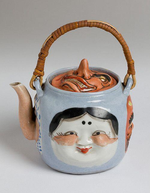 Teapot w masks, woman mask is Otafuku: