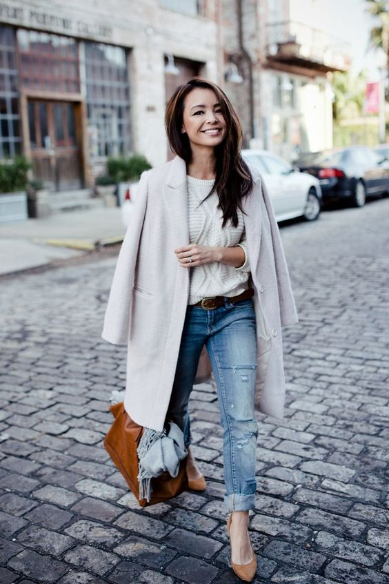 Pairing a grey coat with blue destroyed jeans is a comfortable option for running errands in the city. Finish off your look with tan suede pumps.  Shop this look for $131:  http://lookastic.com/women/looks/cable-sweater-coat-belt-jeans-scarf-tote-bag-pumps/7311  — White Cable Sweater  — Grey Coat  — Dark Brown Leather Belt  — Blue Ripped Jeans  — Grey Scarf  — Brown Leather Tote Bag  — Tan Suede Pumps: