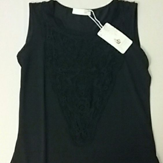 NWT black sleeve less blouse NWT black sleeve less blouse with lace down the middle this says XXL but it's way smaller then that more of an 8 Tops Blouses