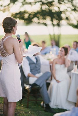 maid of honor giving delivering speech to bride