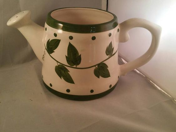 Hey, I found this really awesome Etsy listing at https://www.etsy.com/listing/454626588/vintage-ceramic-watering-can-flower-pot
