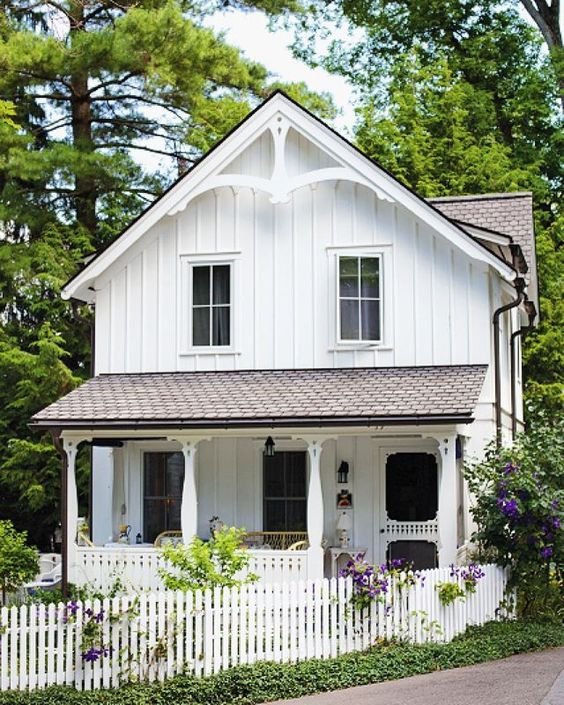 Simple, charming, and with a porch made for easy summer days, we adore this…: