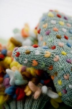 Knitted mittens with embroidered #hearts
