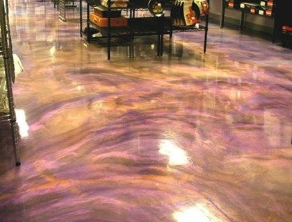 Stained concrete floors kitchen using a black pigmented for Black stains on concrete