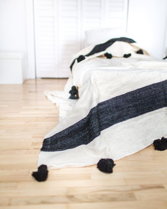 The Moroccan Pom Pom Blanket is a beautiful accessory for the Bohemian style home. It can be used as a blanket, coverlet for the bed or throw for