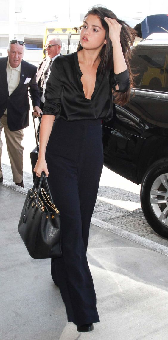 Selena Gomez Makes a Statement in a Plunging Blouse and High-Waisted Pants from #InStyle