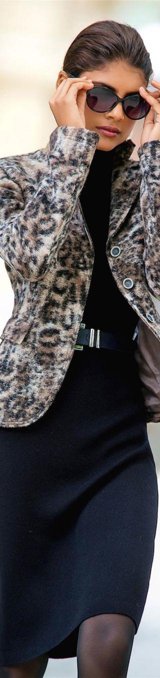 Black midi dress, snow leopard jacket