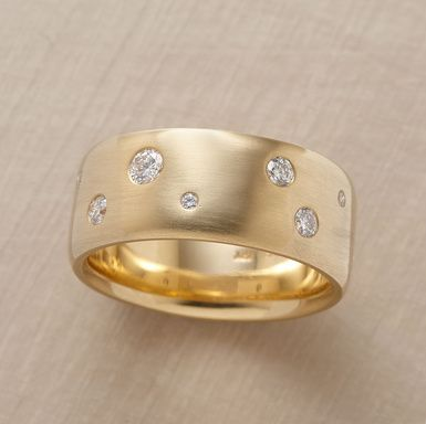 A glittering constellation of diamonds spreads over Anne Sportun's weighty band…seven sparklers in all. The 14kt gold is burnished to a soft and subtle matte finish, the better to showcase the glittering gems. .28 approximate total carat weight. Handcrafted in Canada. Whole sizes 6 to 8.