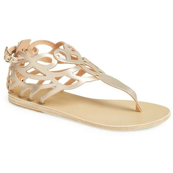 Ancient Greek Sandals 'Medea' Cutout Thong Sandal ($71) ❤ liked on Polyvore featuring shoes, sandals, metal sand, leather shoes, metallic sandals, cut out wedge sandals, thong sandals e studded sandals